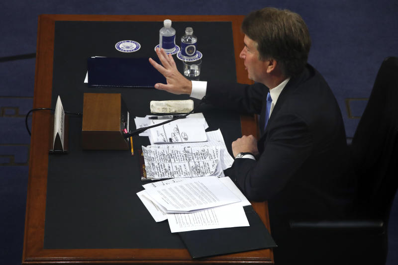 President Donald Trump's Supreme Court nominee, Brett Kavanaugh gestures over a small U.S. Constitution and his notes while testifying before the Senate Judiciary Committee on Capitol Hill in Washington, Wednesday, Sept. 5, 2018, on the second day of his confirmation hearing to replace retired Justice Anthony Kennedy. (AP Photo/Jacquelyn Martin)