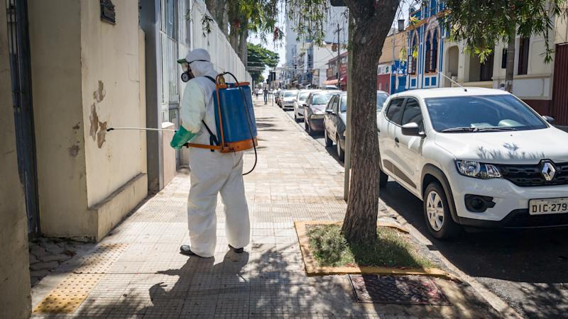 Disinfection of streets of downtown Franca, Sao Paulo, Brazil, on 30 April 2020, as a measure against the spread of the new coronavirus, which transmits the covid-19. (Photo by Igor Do Vale/NurPhoto via Getty Images)