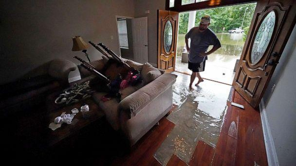 PHOTO: Danny Gonzales, walks in his flooded house as water recedes, after Tropical Storm Claudette passed through, in Slidell, La., June 19, 2021. (Gerald Herbert/AP)