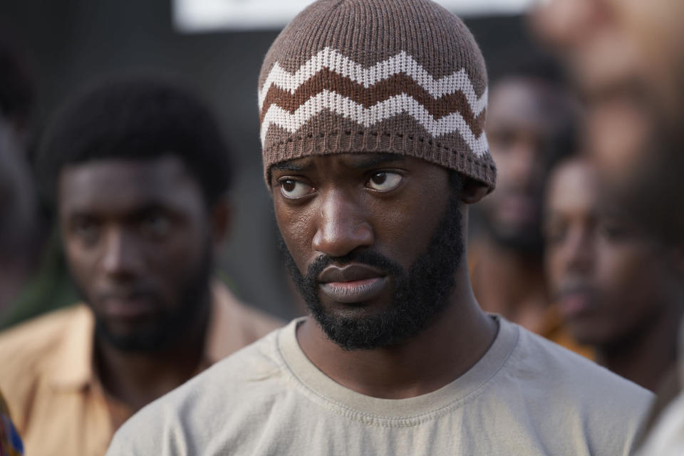 """This image released by Amazon Prime Video shows Malachi Kirby as Darcus Howe in a scene from """"Mangrove."""" (Des Willie/Amazon Prime Video via AP)"""