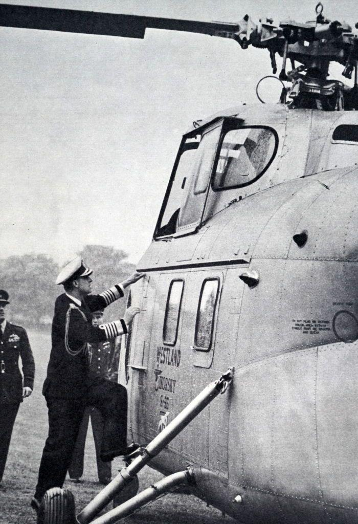 """<p>The Duke of Edinburgh inspecting a helicopter in the grounds of <a href=""""https://www.goodhousekeeping.com/uk/lifestyle/travel/a26943853/buckingham-palace-tour-jennie-bond/"""" rel=""""nofollow noopener"""" target=""""_blank"""" data-ylk=""""slk:Buckingham Palace"""" class=""""link rapid-noclick-resp"""">Buckingham Palace</a> in 1953.</p>"""