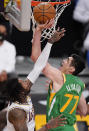 Utah Jazz forward Ersan Ilyasova, right, shoots as Los Angeles Lakers guard Ben McLemore defends during the first half of an NBA basketball game Saturday, April 17, 2021, in Los Angeles. (AP Photo/Mark J. Terrill)