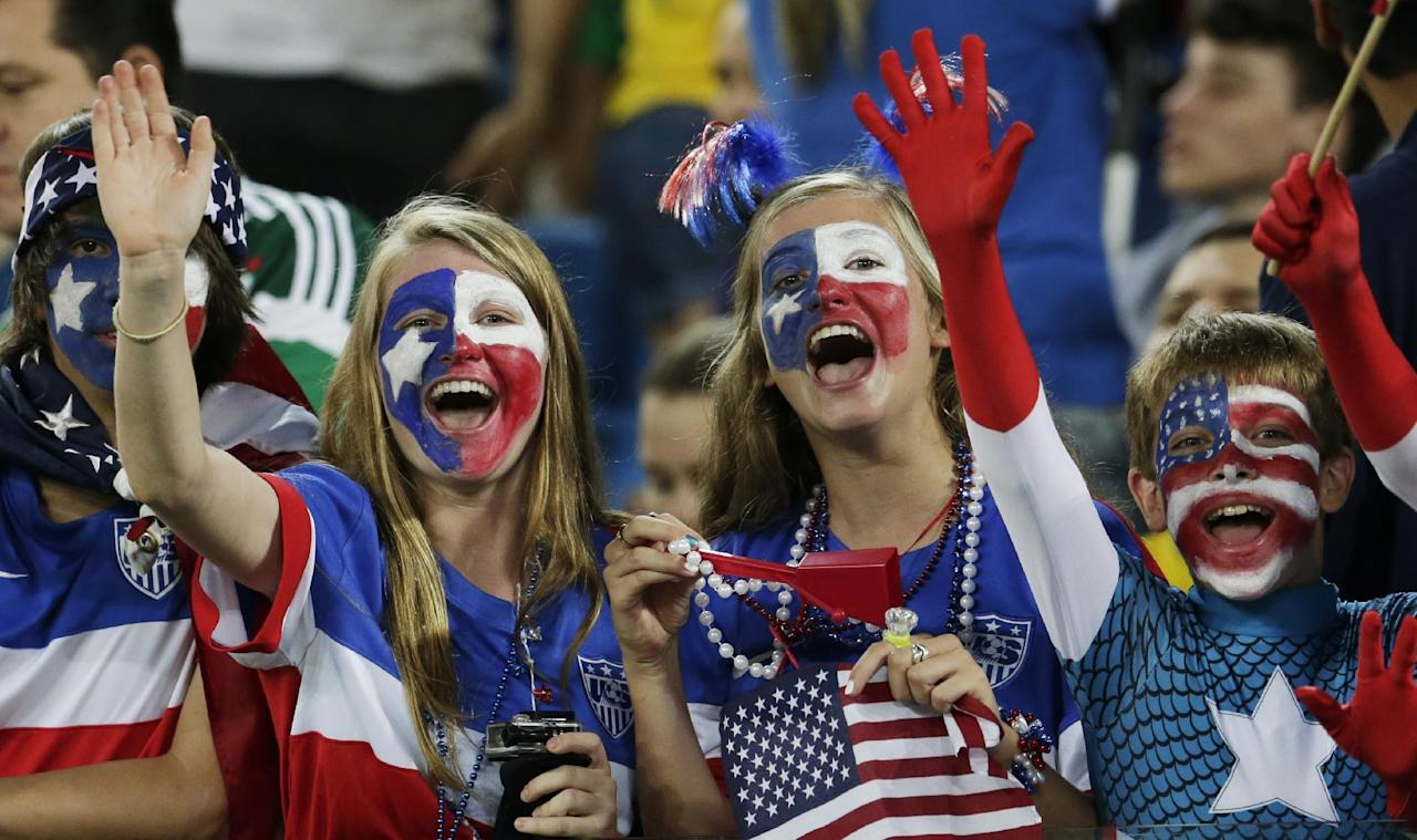 American fans cheer for their team before the group G World Cup soccer match between Ghana and the United States at the Arena das Dunas in Natal, Brazil, Monday, June 16, 2014.  (AP Photo/Petr David Josek)