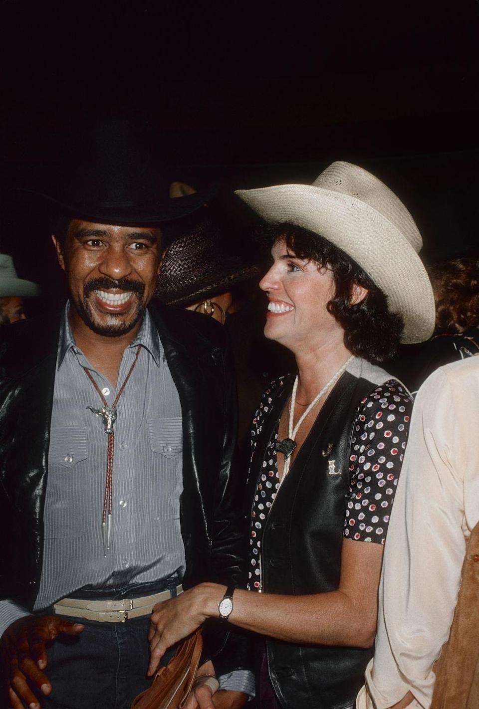 """<p>Jennifer Lee met comedian Richard Pryor in 1977, after being <a href=""""https://people.com/movies/sex-drugs-and-comedy-inside-richard-pryors-chaotic-love-life/"""" rel=""""nofollow noopener"""" target=""""_blank"""" data-ylk=""""slk:hired to decorate his home"""" class=""""link rapid-noclick-resp"""">hired to decorate his home</a>. The couple said """"I do"""" in 1981 and were married for a year before divorcing. After their marriage, Richard married Flynn Belaine (twice!), but reconciled with Jennifer in 1994 after a diagnosis of degenerative multiple sclerosis. They got married for the second time in 2001 and were together until his death in 2005. </p>"""