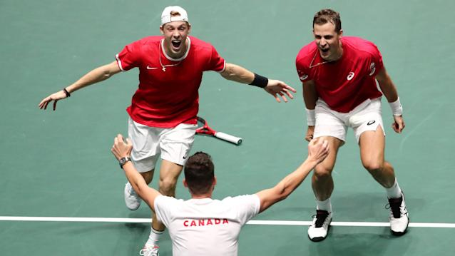 Canada's Denis Shapovalov and Vasek Pospisil celebrate after winning their doubles match against Australia's John Peers and Jordan Thompson. (REUTERS/Sergio Perez)