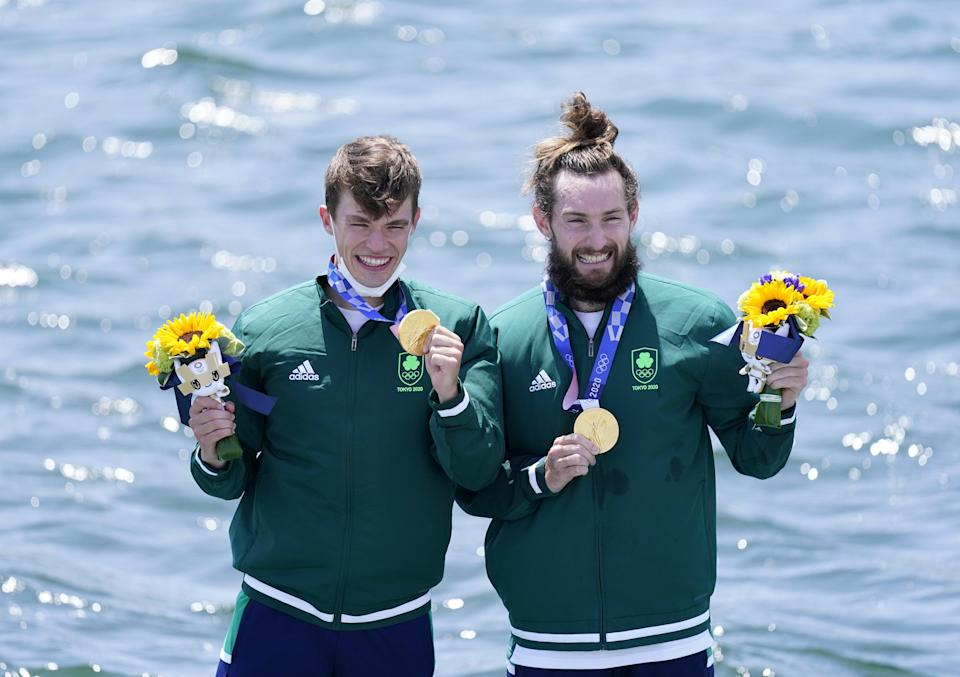 Fintan McCarthy and Paul O'Donovan on the podium following their Olympic win (Danny Lawson/PA) (PA Wire)