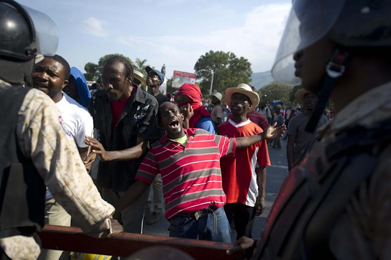 Demonstrators march during a protest against the government of President Michel Martelly in Port-au-Prince, on December 13, 2014 (AFP Photo/Hector Retamal)