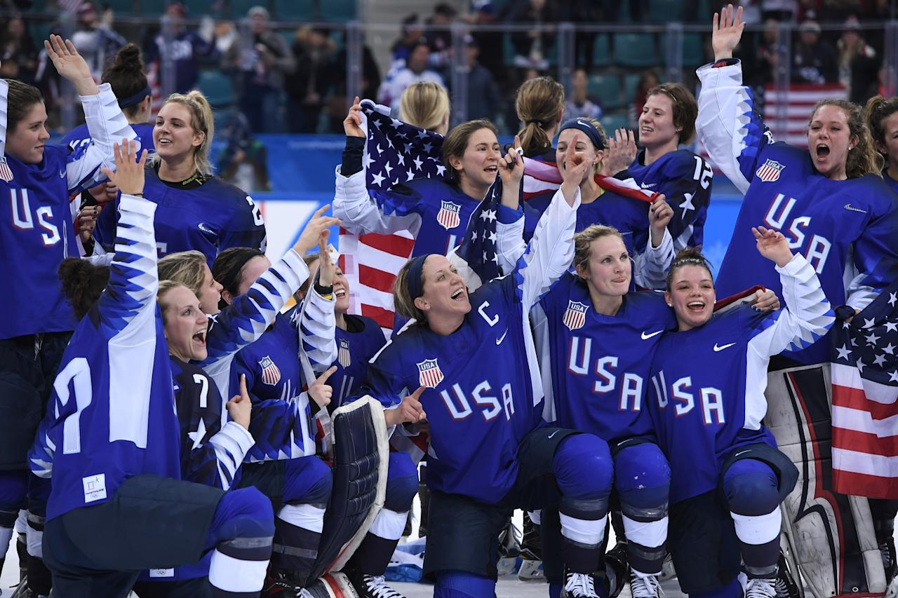 <p>The US team celebrates winning the women's gold medal ice hockey match between the US and Canada during the Pyeongchang 2018 Winter Olympic Games at the Gangneung Hockey Centre in Gangneung on February 22, 2018. / AFP PHOTO / JUNG Yeon-Je </p>