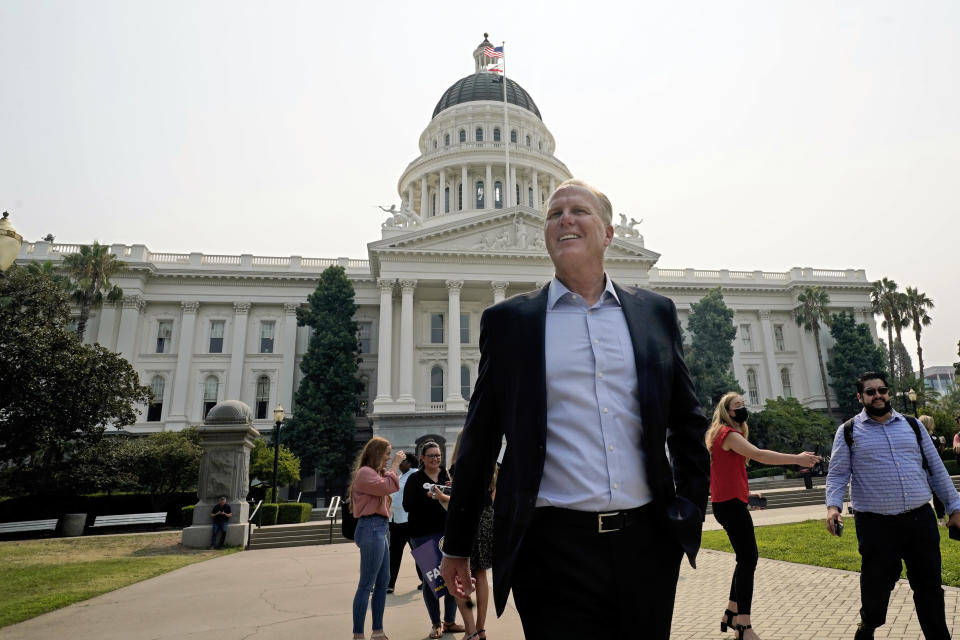FILE — In this Aug. 20, 2021 file photo Republican Kevin Faulconer, a candidate for governor in the California recall election, leaves the state Capitol after meeting with supporters in Sacramento, Calif. Faulconer is running to replace Democratic Gov. Gavin Newsom in the Sept. 14 recall election. Democrats hope hope they can keep Newsom in office by driving up turnout.(AP Photo/Rich Pedroncelli, File)