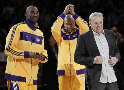 Lakers owner Jerry Buss dishes out the championship jewelry to Kobe Bryant and Derek Fisher in 2010. (AP)