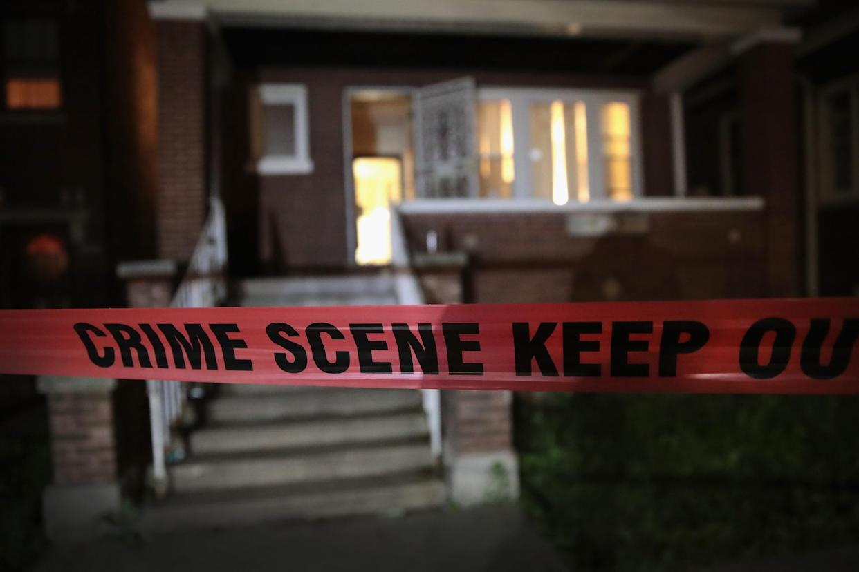 Police tape is shown around a house. Authorities are still investigating a shooting in Colerain Township, Ohio that injured eight: Scott Olson/Getty Images