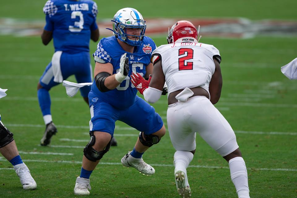 Kentucky center Drake Jackson (65) blocks North Carolina State Wolfpack linebacker Jaylon Scott (2) during the TaxSlayer Gator Bowl. (Photo by David Rosenblum/Icon Sportswire via Getty Images)