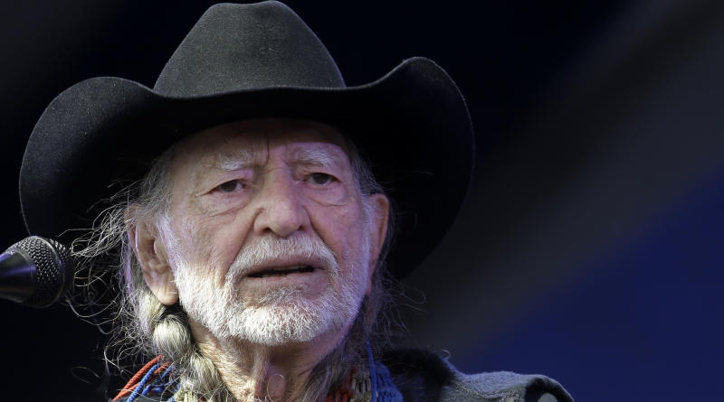 FILE - This May 3, 2013 file photo shows Willie Nelson performing at the New Orleans Jazz and Heritage Festival in New Orleans. A missing toy armadillo with a connection to Nelson has sparked a search in the New York suburbs. The Capitol Theater's general manager says a stuffed armadillo beloved by a member of Nelson's crew was stolen from the stage after a Nelson concert last Thursday, Sept. 19, 2013. (AP Photo/Gerald Herbert, file)