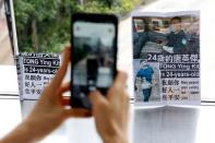 Leaflets in support of Tong Ying-kit, the first person charged under a new national security law, are placed at a shopping mall near the High Court, in Hong Kong
