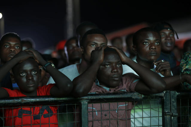 Nigeria's national soccer team fans reacts after Luka Modric scores the winning goal during a televised broadcast of the Russia 2018 World Cup match between Croatia and Nigeria, in Lagos, Nigeria, Saturday, June 16, 2018. (AP Photo/Sunday Alamba)