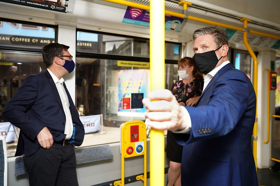 <p>Keir Starmer campaigning with Andy Burnham in Manchester, whose mayoral election is likely to be a 'Labour hold'</p> (PA)