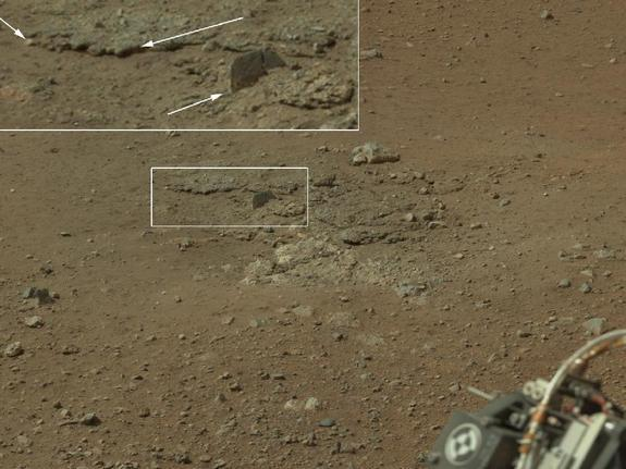This color image from NASA's Curiosity rover, taken on Aug. 8, 2012, shows an area excavated by the blast of its sky crane rocket engines.