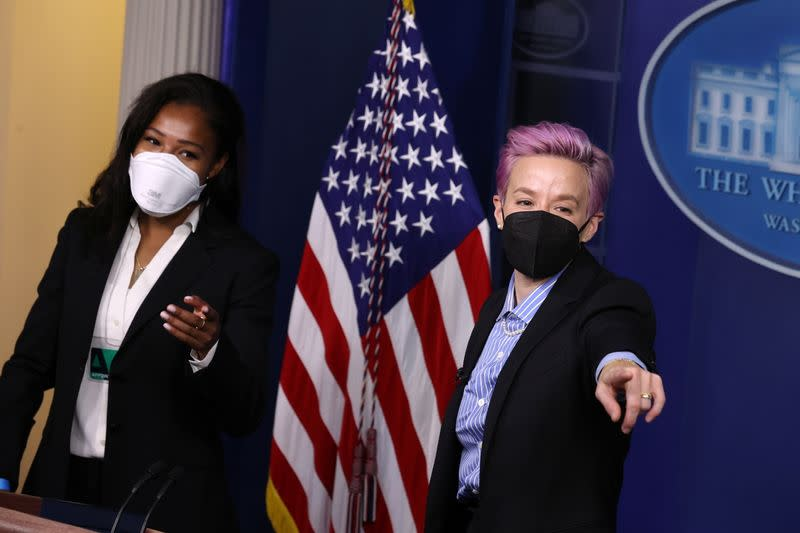 U.S. Women's National Soccer Team players Purce and Rapinoe pose for pictures at the lectern in the press briefing room at the White House in Washington
