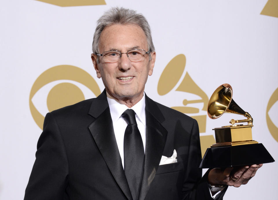 """FILE - Al Schmitt poses in the press room with the award for best surround sound album for """"Live Kisses"""" at the 56th annual GRAMMY Awards on Jan. 26, 2014, in Los Angeles. Schmitt, one of the world's most honored musical producers and engineers has died. The Grammy winner, who worked with everyone from Sam Cooke to Steely Dan to Frank Sinatra, was 91. (Photo by Dan Steinberg/Invision/AP, File)"""