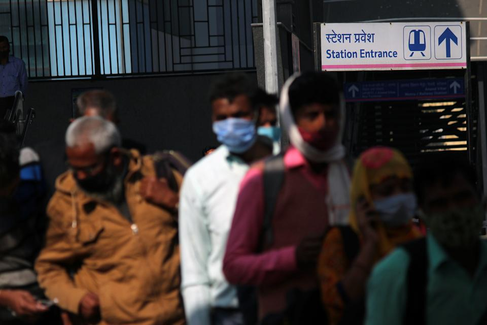 Commuters with covered face wait to get tested for COVID-19, during a testing campaign for the coronavirus disease, at Anand Vihar ISBT in New Delhi, India on February 25, 2021. A total of 16,738 new daily cases have been recorded in a span of 24 hours. India's Covid-19 active cases were recorded at 1,51,708, the Union health ministry said on Thursday, highlighting that the surge was due to rise in daily new cases in some states like Maharashtra, Kerala, Punjab, Madhya Pradesh, Tamil Nadu, Gujarat and Chhattisgarh.  (Photo by Mayank Makhija/NurPhoto via Getty Images)