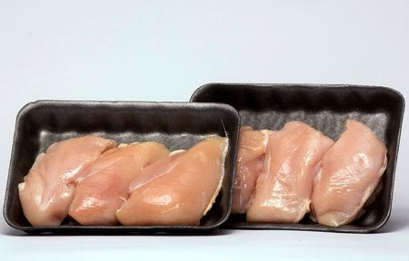 FILE PHOTO: Packaged chicken breasts are pictured in New York, U.S., March 11, 2015. REUTERS/Lucas Jackson/File Photo