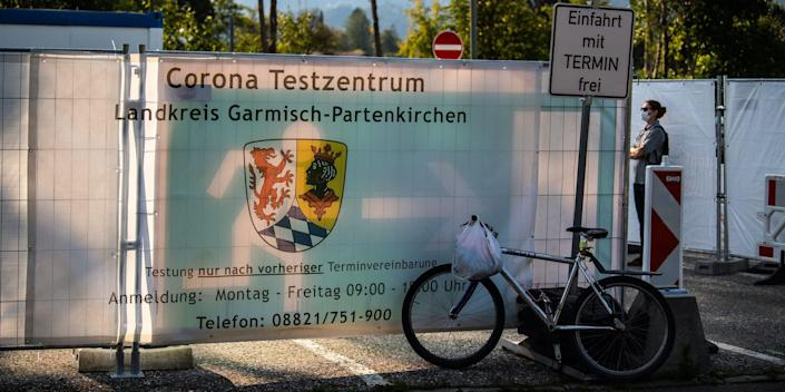 13 September 2020, Bavaria, Garmisch-Partenkirchen: One person is standing in front of the Corona test centre of the city. After a violent corona outbreak in Garmisch-Partenkirchen, Upper Bavaria, it is still unclear what consequences the suspected culprit must expect. The authorities assume that the outbreak was caused by a so-called superspreader. Photo: Lino Mirgeler/dpa (Photo by Lino Mirgeler/picture alliance via Getty Images)