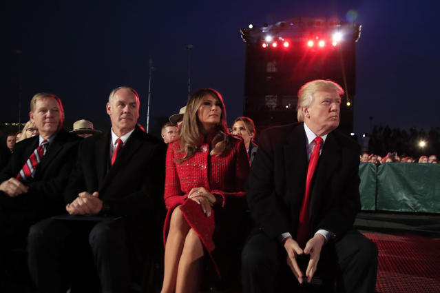<p>President Donald Trump and first lady Melania Trump, watch performances during the National Christmas Tree lighting ceremony at the Ellipse near the White House in Washington, Thursday, Nov. 30, 2017, with Interior Secretary Ryan Zinke, second from left. (Photo: Manuel Balce Ceneta/AP) </p>