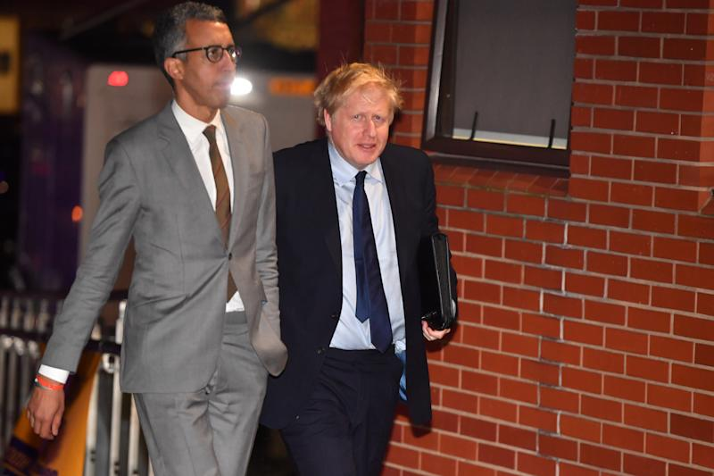 SHEFFIELD, UNITED KINGDOM - NOVEMBER 22: British Prime Minister Boris Johnson walks with Editorial Director of BBC News Kamal Ahmed (L) as he arrives to take part in BBC Question Time leaders' special at The Octagon Centre on November 22, 2019 in Sheffield, England. The leaders of the Conservatives, Labour, Liberal Democrats and the SNP will be taking part in the live General Election Question Time special, hosted by Fiona Bruce, and will each have 30 minutes to answer questions from the audience. (Photo by Anthony Devlin/Getty Images)