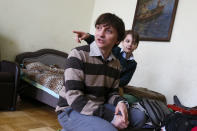 """Volodymyr Yavorskyy and his son, Danila, speak to journalists in Kyiv, Ukraine, Friday, May 28, 2021. Yavorskyy and the youth were ordered to leave Belarus and were barred from returning for 10 years. His wife, Tatsiana Hatsura-Yavorska, was arrested in Belarus on charges of """"organizing actions that violate public order,"""" and cannot leave the country. (AP Photo/Efrem Lukatsky)"""