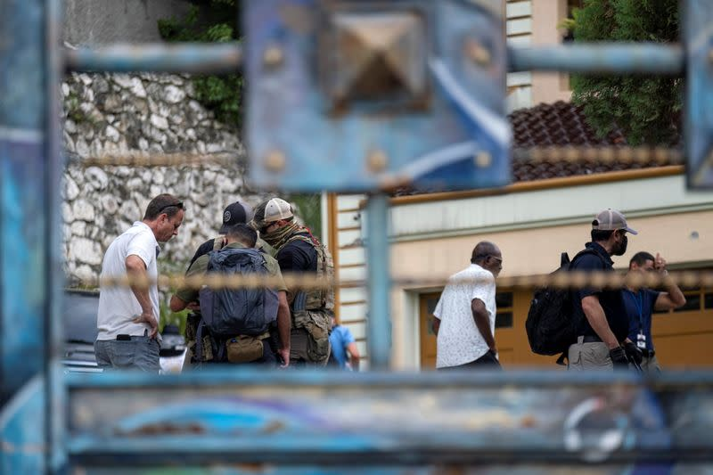 FILE PHOTO: FBI agents inspect the property of late President Moise in Port-au-Prince