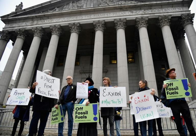 Some environmental activists attended a Manhattan hearing in the unprecedented trial against Exxon after protesting outside of court (AFP Photo/Angela Weiss)