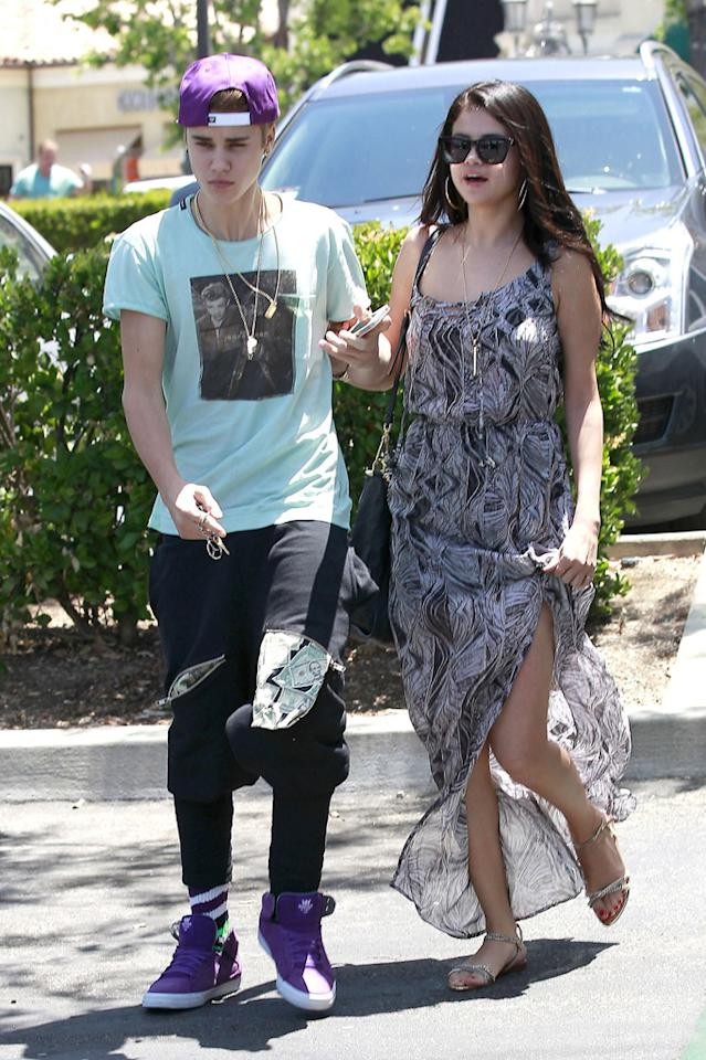 """Unfortunately, Justin Bieber and Selena Gomez didn't exactly start the holiday weekend off on  the right foot. On Sunday, the """"Boyfriend"""" singer was accused of  attacking a photographer who got a little too close, and the pap  actually called police and an ambulance to take him to the hospital for  chest pains. Before the altercation, the lovebirds shared a romantic  movie date in Calabasas, California. (5/27/2012)"""