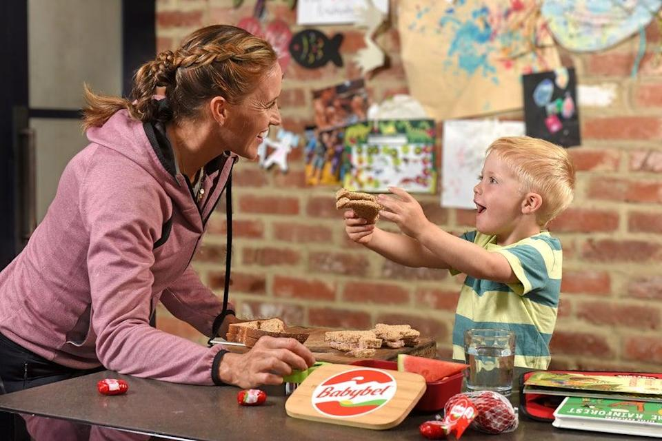 Play time: Helen Glover plays with her son Logan (PA/Babybel)
