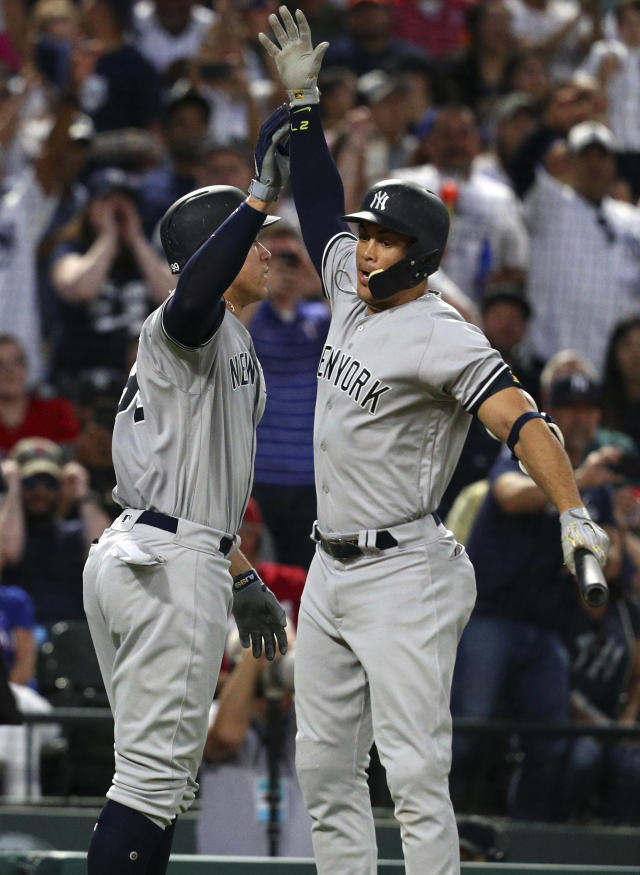 New York Yankees Aaron Judge (99) celebrates his fifth inning home run with Giancarlo Stanton (27) against the Texas Rangers in a baseball game Monday, May 21, 2018, in Arlington, Texas. (AP Photo/Richard W. Rodriguez)
