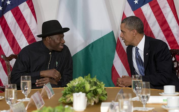 """FILE - President Barack Obama meets with Nigerian President Goodluck Jonathan in New York, in this Monday, Sept. 23, 2013 file photo. The Associated Press on Monday Jan. 13 2014 obtained a copy of the previously unannounced Same Sex Marriage Prohibition Act that was signed by President Jonathan and dated Jan. 7 that bans same-sex marriage and criminalizes homosexual associations, societies and meetings, with penalties of up to 14 years in jail. Secretary of State John Kerry said Monday the United States was """"deeply concerned"""" by a law that """"dangerously restricts freedom of assembly, association, and expression for all Nigerians."""" (AP Photo/Pablo Martinez Monsivais, File)"""