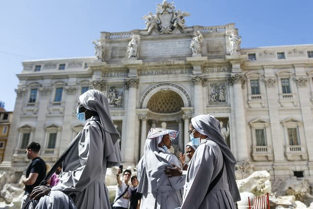 Nuns walk past the Trevi fountain in Rome (Cecilia Fabiano/AP)