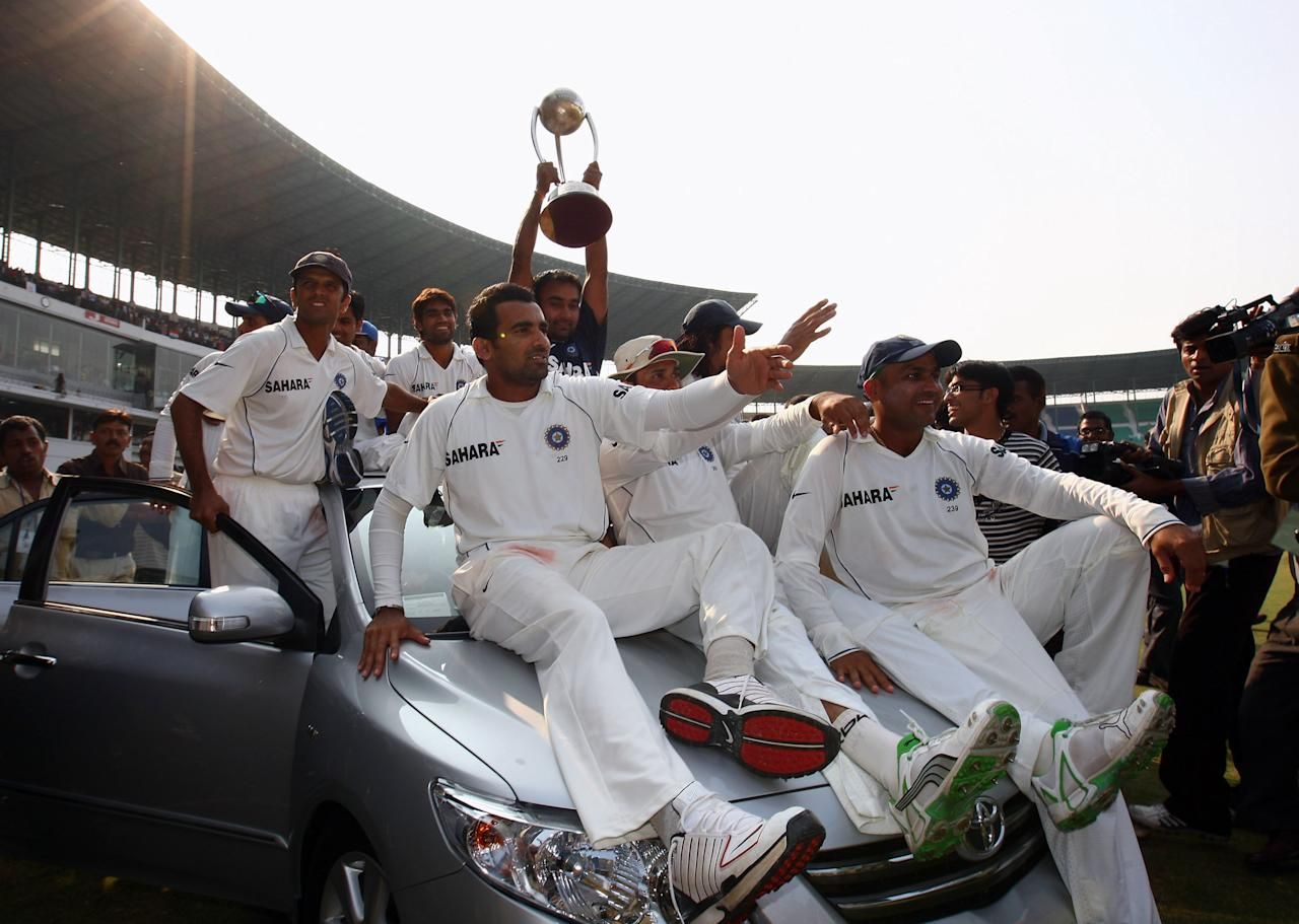 NAGPUR, INDIA - NOVEMBER 10:  The Indian team are driven on top of a car on a lap of honour on day five of the Fourth Test match between India and Australia at Vidarbha Cricket Association Stadium on November 10, 2008 in Nagpur, India.  (Photo by Michael Steele/Getty Images)