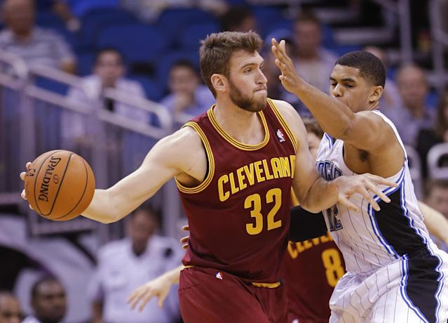 Cleveland Cavaliers' Spencer Hawes (32) passes the ball as Orlando Magic's Tobias Harris, right, defends him during the second half of an NBA basketball game in Orlando, Fla., Wednesday, April 2, 2014. Cleveland won 119-98. (AP Photo/John Raoux)