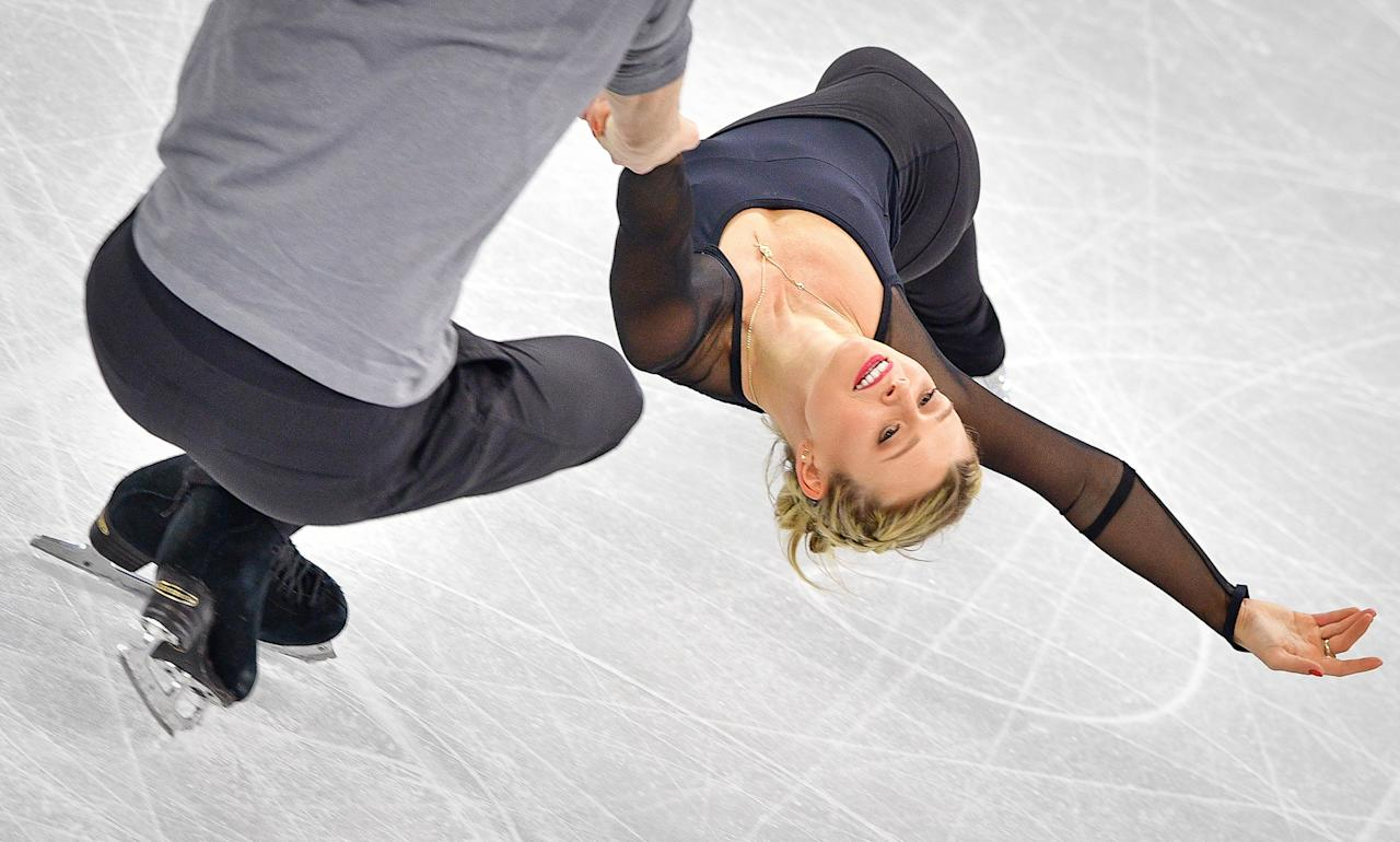 <p>Kirsten Moore-Towers and Michael Marinaro of Canada practise at Gangneung Ice Arena ahead of the pairs figure skating competition of the PyeongChang 2018 Winter Olympic Games on February 8, 2018. (Photo credit should read MLADEN ANTONOV/AFP/Getty Images) </p>