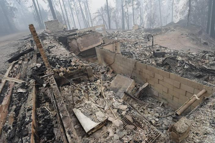 The fire-gutted ruins of a home at Meadow Lakes, Sept. 12, 2020.