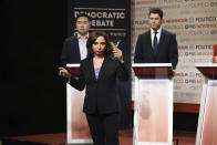"""This image released by NBC shows Bowen Yang as Andrew Yang, from left, Maya Rudolph as Kamala Harris, and Colin Jost as Pete Buttigieg during the """"Democratic Debate"""" cold open on """"Saturday Night Live"""" on Dec. 21, 2019. Rudolph won the award for outstanding guest actress in a comedy series during the Creative Arts Emmy Awards on Saturday, Sept. 19, 2020. (Will Heath/NBC via AP)"""