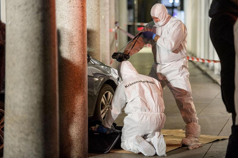 Police officers investigate the car used by a man to plough into pedestrians before he was shot by police on February 25, 2017 (AFP Photo/Thomas Lohnes)