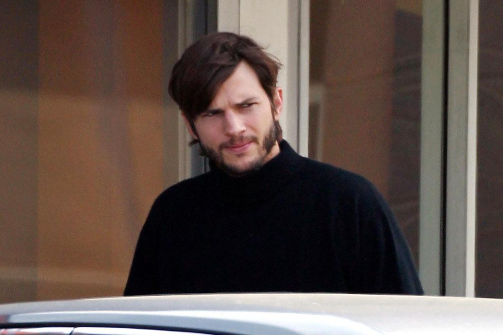 Ashton Kutcher looks the spitting image of a young Steve Jobs as he grabs a coffee near his home before heading to a film studio.