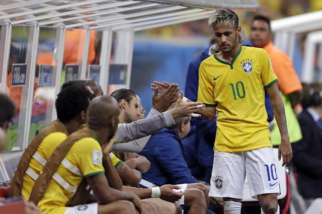 Brazil's Neymar shakes hands after he was substituted during the group A World Cup soccer match between Cameroon and Brazil at the Estadio Nacional in Brasilia, Brazil, Monday, June 23, 2014. (AP Photo/Andre Penner)