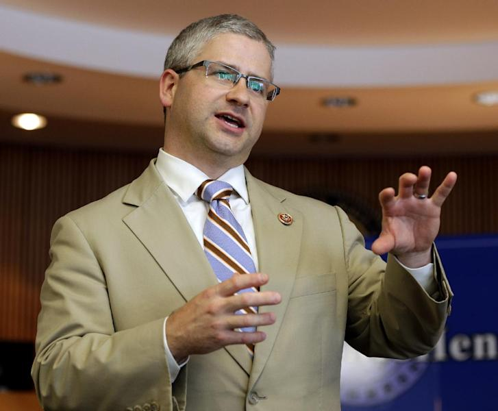 FILE - In this Aug. 5, 2013 file photo, Rep. Patrick McHenry, R-N.C. speaks in Lincolnton, N.C. The 2012 election should ave been a good one for Democrats running for Congress in North Carolina. Together, they received a total of 2.2 million votes_nearly 100,000 more than their Republican opponents. But when the votes were divvied up among the state's 13 House districts, the Democrats came up shot, way short. (AP Photo/Chuck Burton, File)