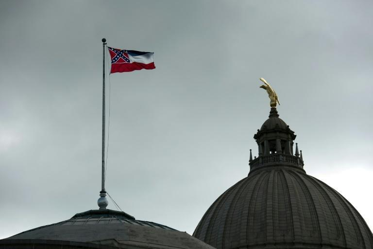 The Mississippi state flag flies over the state capitol building in Jackson, Mississippi, as lawmakers voted to remove the Confederate battle symbol from the flag (AFP Photo/Rory Doyle)
