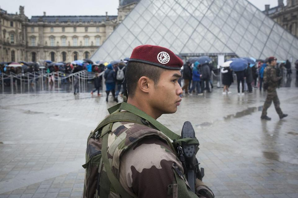 """A French soldier patrols in the courtyard of the Louvre museum in Paris, Saturday, Feb. 4, 2017. The Louvre in Paris reopened to the public Saturday morning, less than 24-hours after a machete-wielding assailant shouting """"Allahu Akbar!"""" was shot by soldiers, in what officials described as a suspected terror attack. (AP Photo/Kamil Zihnioglu)"""