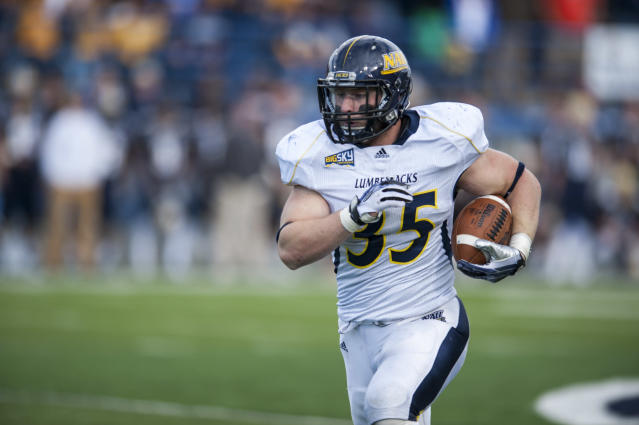 In this photo provided by Montana State University, Northern Arizona linebacker Austin Hasquet returns an interception for touchdown during the third quarter of an NCAA college football game against Montana State Saturday, Oct. 5, 2013 in Bozeman, Mont. (AP Photo/Montana State University, Kelly Gorham)