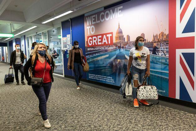 Passengers in protective face masks are seen arriving at London Stansted Airport as the airline industry tries to recover after global Coronavirus lockdown cut most of international passenger flights - London, England on September 14, 2020. (Photo by Dominika Zarzycka/NurPhoto via Getty Images) (Photo: NurPhoto via Getty Images)