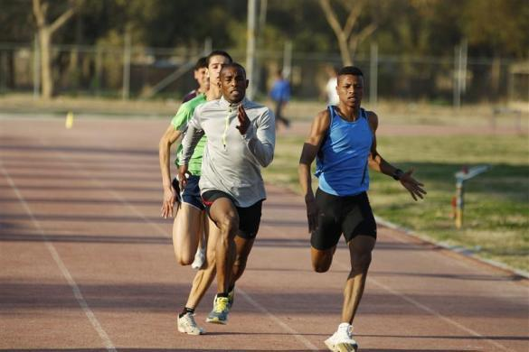 Iraqi athlete Adnan Taess (front L) exercises during a training session in Baghdad University February 27, 2012.